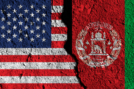 Crack between America and Afghanistan flags. political relationship concept