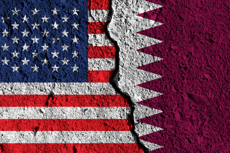 Crack between America and Qatar flags. political relationship concept Stock Photo