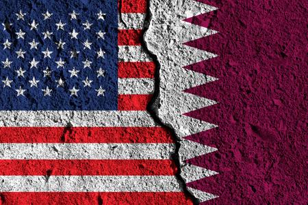 Crack between America and Qatar flags. political relationship concept Reklamní fotografie