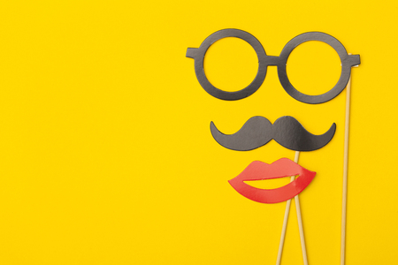 Photobooth props on a yellow background. Birthday, wedding party celebration