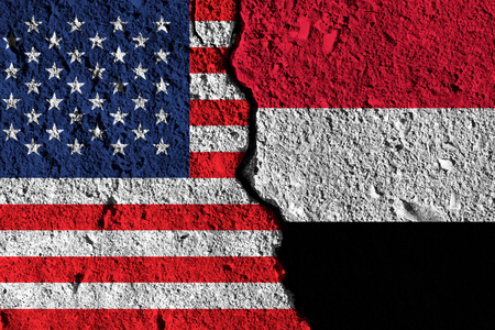 Crack between America and Yemen flags. political relationship concept