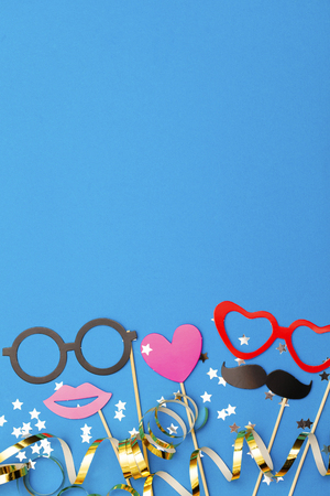 Party props on a blue background. Birthday, wedding party celebration