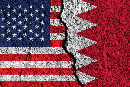 Crack between America and Bahrain flags. political relationship concept