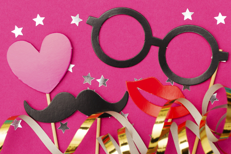 Fun party props on a pink background. Wedding, hen do party photobooth.