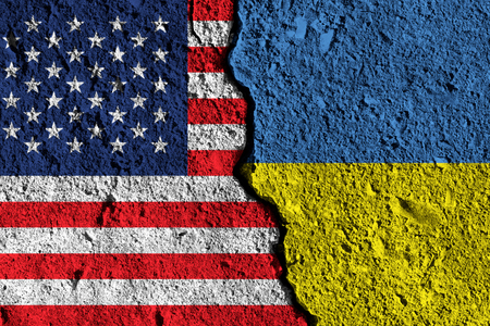 Crack between America and Ukraine flags. political relationship concept