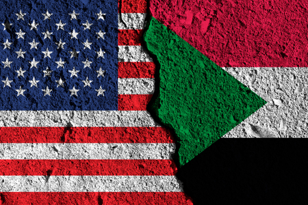 Crack between America and Sudan flags. political relationship concept