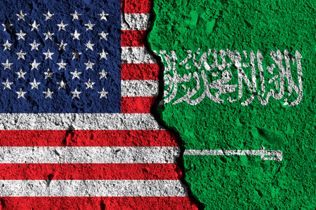 Crack between America and Saudi Arabia flags. political relationship concept Stock Photo
