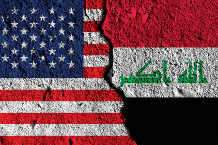 Crack between America and Iraq flags. political relationship concept