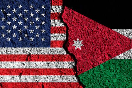 Crack between America and Jordan flags. political relationship concept