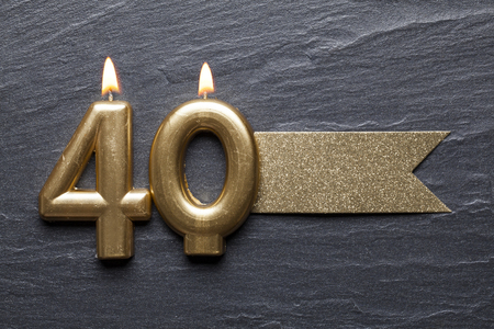 Gold number 40 celebration candle with glitter label
