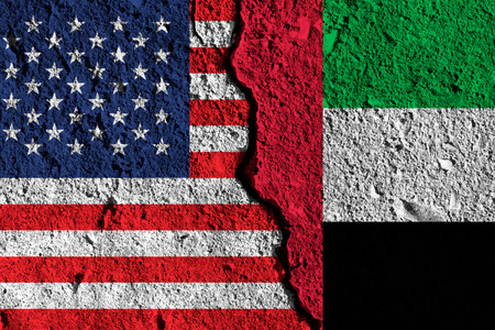 Crack between America and UAE flags. political relationship concept