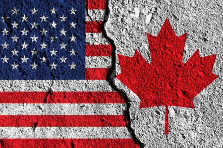 Crack between America and Canada flags. political relationship concept