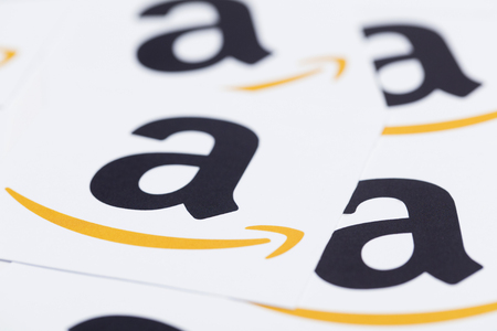 Amazon logo printed onto paper. Amazon is the largest online retailer in the world and was founded in 1994 Редакционное