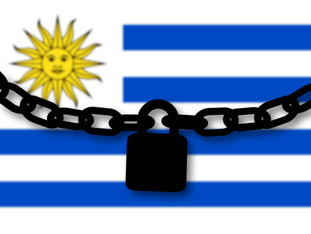 Uruguay security. Silhouette of a chain and padlock over national flag Stock Photo