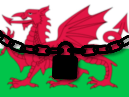 Wales security. Silhouette of a chain and padlock over national flag