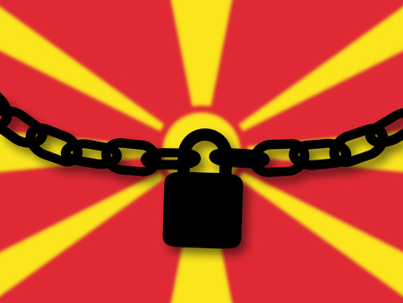 Macedonia security. Silhouette of a chain and padlock over national flag Stock Photo