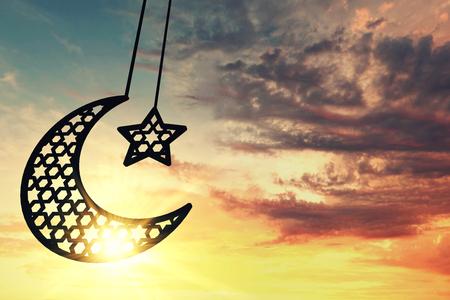 Ramadam Kareem moon and star against sunrise/sunset background. 3D Rendering Standard-Bild - 92951371