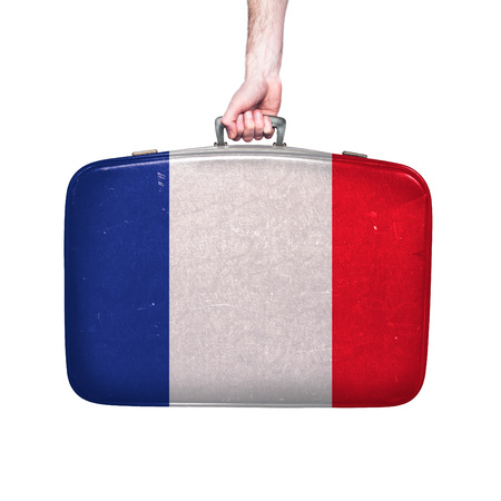 France flag on a vintage leather suitcase. Stock Photo