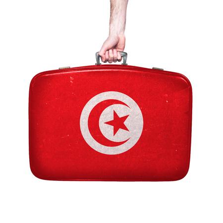 Tunisia flag on a vintage leather suitcase.