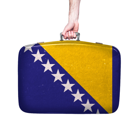 bosnia flag on a vintage leather suitcase.
