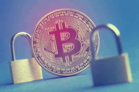 bitcoin currency coin with a padlock. Digital currency security concept