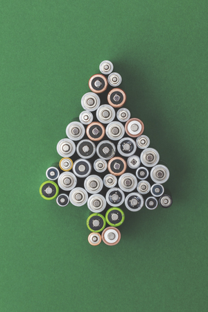 Festive christmas tree shape made from old batteries Stock Photo
