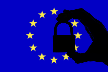 European Union security. Silhouette of hand holding a padlock over national flag