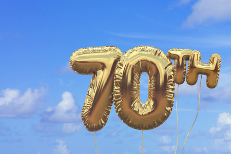 Gold number 70 foil birthday balloon against a bright blue summer sky. Golden party celebration. 3D Rendering