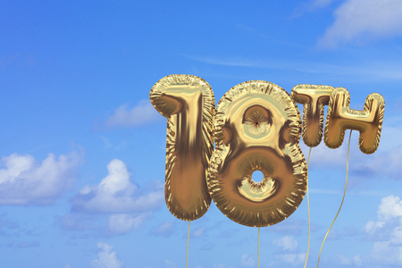 Gold number 18 foil birthday balloon against a bright blue summer sky. Golden party celebration. 3D Rendering
