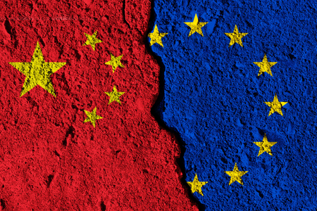 Crack between European union and China flags. political relationship concept