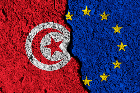 Crack between European union and Tunisia flags. political relationship concept