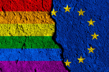 Crack between European union and Gay pride flags. political relationship concept
