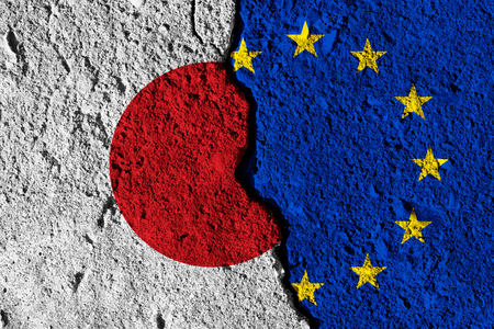 Crack between European union and Japan flags. political relationship concept