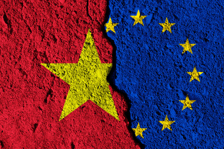 Crack between European union and Vietnam flags. political relationship concept