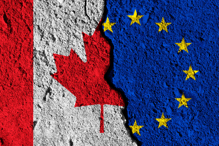 Crack between European union and Canada flags. political relationship concept