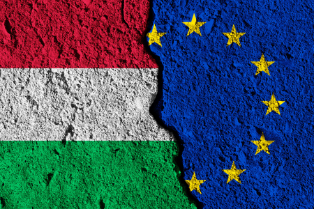 Crack between European union and Hungary flags. political relationship concept