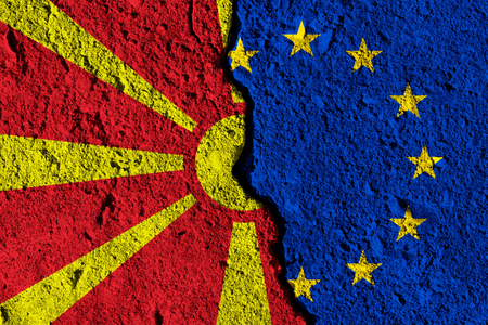 Crack between European union and Macedonia flags. political relationship concept Stock Photo