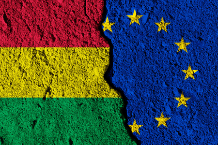 Crack between European union and Bolivia flags. political relationship concept