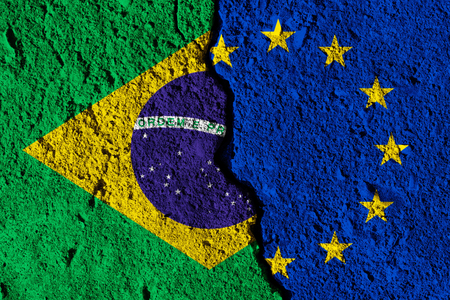 Crack between European union and Brazil flags. political relationship concept