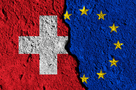 Crack between European union and Switzerland flags. political relationship concept Stock Photo