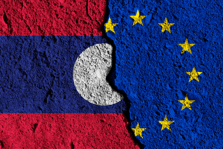 Crack between European union and Laos flags. political relationship concept Stock Photo