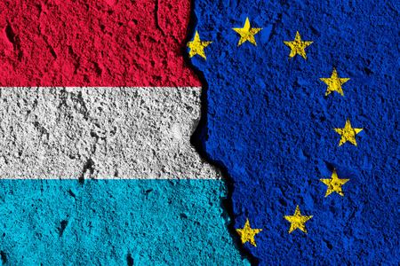 Crack between European union and Luxembourg flags. political relationship concept