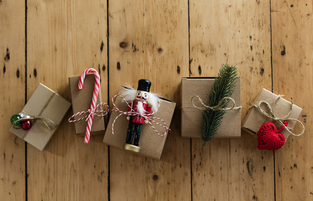 Christmas present wrapped boxes on a wooden background