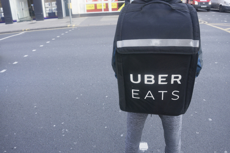 LONDON, UK - January 26th 2018: Uber eats delivery perosn wearing an uber eats delivery backpack