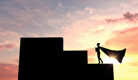 Silhouette of a superhero business woman wearing a cape against a bright sky. 3D Rendering