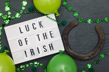 Luck of the irish message on a lightbox with St Patricks decorations