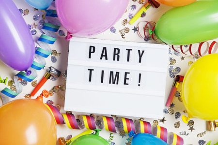 Party celebration background with party time message on a lightbox Stock Photo