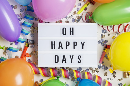 Party celebration background with oh happy days message on a lightbox