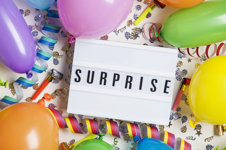 Party celebration background with surprise message on a lightbox