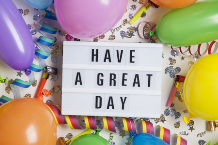 Party celebration background with have a great day message on a lightbox